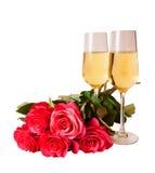 Champagne e rose rosa isolate su bianco Fotografie Stock Libere da Diritti