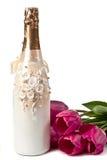 Champagne e tulips Fotos de Stock