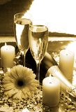 Champagne e velas Fotografia de Stock Royalty Free