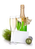 Champagne, empty card and christmas decor Royalty Free Stock Photography