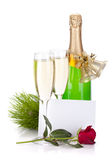 Champagne, empty card and rose flower Stock Image