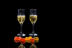 Champagne en snoepjes Stock Afbeeldingen