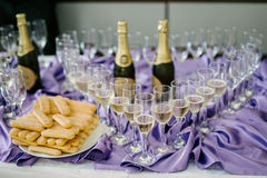 Champagne et biscuits Photo stock