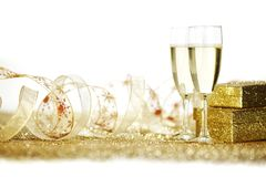 Champagne et cadeaux Photographie stock libre de droits