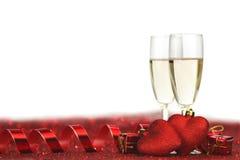 Champagne et coeurs Photographie stock libre de droits
