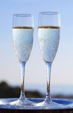 Champagne et coucher du soleil romantique Photographie stock