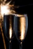 Champagne et feux d'artifice Images stock