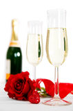 Champagne et roses Photographie stock libre de droits