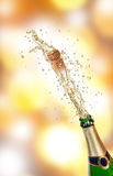 Champagne explosion. With blur shiny background Stock Images
