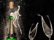 Champagne explosion on black background Stock Image