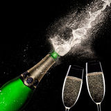 Champagne explosion on black background. Celebration theme Stock Photo