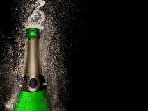 Champagne explosion on black background. Celebration theme Stock Photography