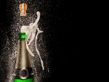 Champagne explosion on black background Royalty Free Stock Image