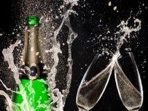 Champagne explosion on black background. Celebration theme Royalty Free Stock Photos