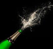Champagne explosion on black background. Celebration theme Stock Images