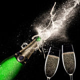 Champagne explosion on black background. Celebration theme Royalty Free Stock Photography