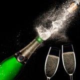 Champagne explosion on black background. Celebration theme Royalty Free Stock Image