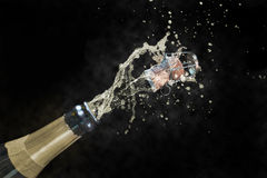 Champagne explosion. Isolated on a black background Stock Photos