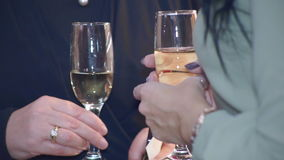 Champagne in Female Hands. Two girls talking and holding in his hand a wine glass with champagne stock video