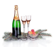 Champagne, fir tree and Christmas decor Royalty Free Stock Image