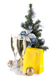 Champagne, fir tree decor and christmas gift Royalty Free Stock Photography