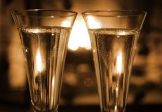 Champagne by the fire Stock Photography
