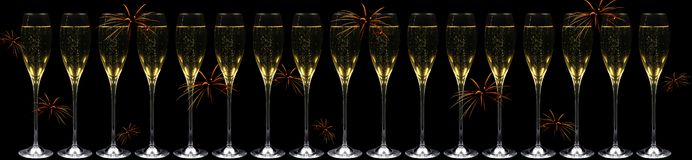 Champagne and fireworks Stock Photos