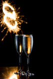 Champagne and fireworks Royalty Free Stock Photography