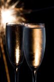 Champagne and fireworks Stock Images