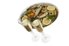 Champagne with fish plate Stock Images