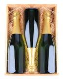 Champagne-Flaschen im hölzernen Fall Stockfotografie