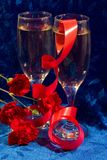 Champagne and flowers Stock Images