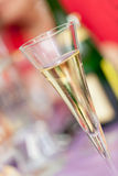 Champagne flute. Champagne glass in front of blurry background Stock Image