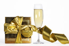 Champagne flute. And golden christmas gift box royalty free stock photography