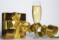 Champagne flute. And golden gift box stock photo