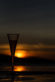 Champagne flute glass against sunset Stock Photos