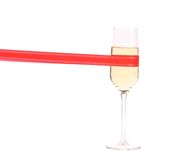 Champagne flute with horisontal red ribbon. Stock Photography