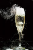 Champagne flute with ice vapor Royalty Free Stock Photography