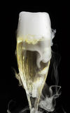 Champagne flute with ice vapor Royalty Free Stock Images