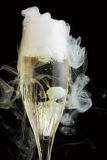 Champagne flute with ice vapor Stock Photography