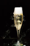 Champagne flute with ice vapor Stock Photos