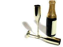 Champagne & flutes. Champagne bottle and two gold flutes royalty free stock photo