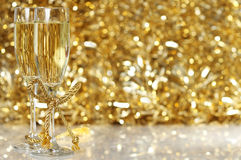 Champagne flutes. With golden background Royalty Free Stock Photos