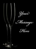 Champagne flutes. Silhouettes of two champagne flutes against a black background. Simple and elegant, with easily removable sample text stock images