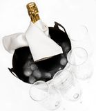 Champagne with flutes. Champagne in ice bucket with 4 flutes royalty free stock photo