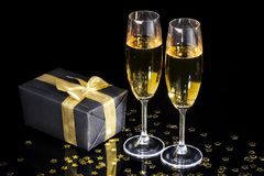 Champagne flutes. Elegant gift box and two champagne flutes for celebration special event stock images