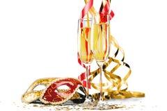 Champagne Flutes avec des flammes et des masques image libre de droits
