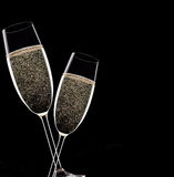 Champagne flutes on black background Royalty Free Stock Photos