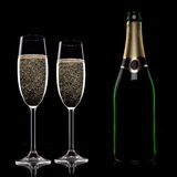 Champagne flutes on black background Royalty Free Stock Image