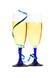 Champagne flutes with blue ribbon closeup Royalty Free Stock Photography
